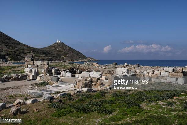 ancient ruins and lighthouse at knidos on a sunny clear day - emreturanphoto stock pictures, royalty-free photos & images