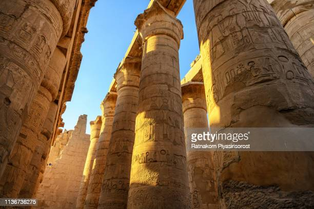 """ancient ruins of karnak temple in egypt,""""nthe karnak temple complex, commonly known as karnak , comprises a vast mix of decayed temples, chapels, pylons, and other buildings near luxor - luxor thebes stock pictures, royalty-free photos & images"""