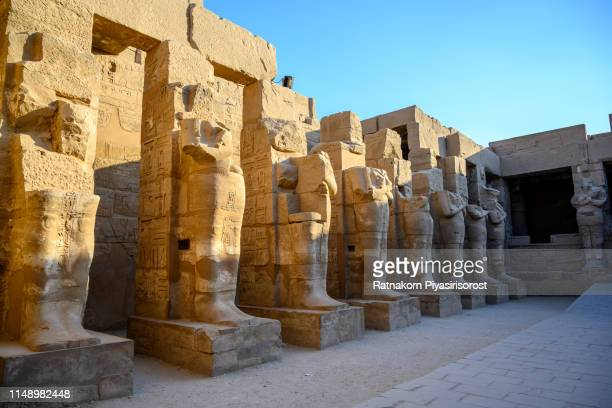 """ancient ruins of karnak temple in egypt,""""r""""nthe karnak temple complex, commonly known as karnak , comprises a vast mix of decayed temples, chapels, pylons, and other buildings near luxor - abu simbel stock pictures, royalty-free photos & images"""