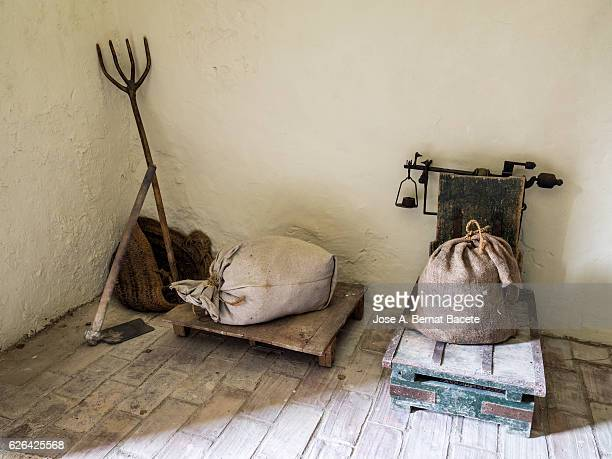 Ancient rural big scale, to weigh the crops of the field in sacks of burlap, and tools of work for the field