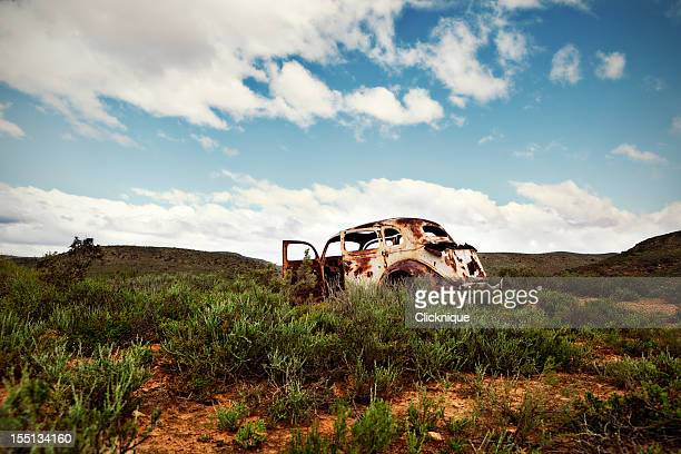 Ancient, rusted car body abandoned in remote countryside