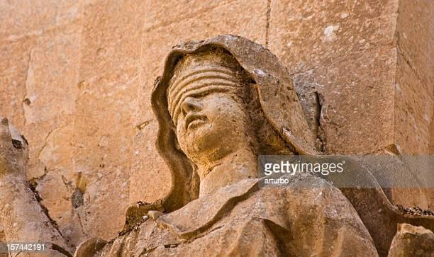 ancient sandstone Lady Justice portrait
