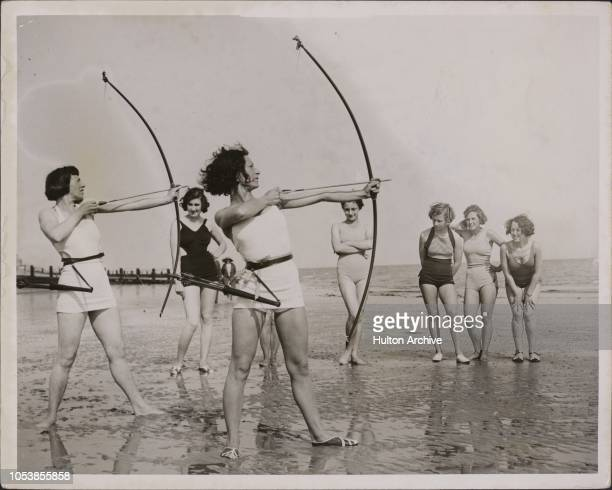 Ancient Sport For Miss Modern Archery is growing in popularity but these girls on the beach at Worthing played in garb that would have given a shock...