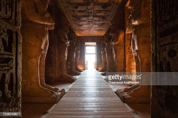 ancient statues inside the corridor of the great temple of ramses ii in abu simbel egypt - egypt stock pictures, royalty-free photos & images