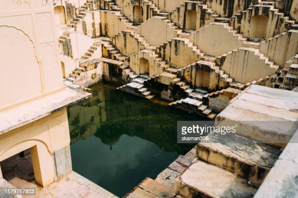 ancient stepwell chand baori biggest stepwell near jaipur rajasthan india - abhaneri stock pictures, royalty-free photos & images