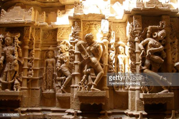 ancient stone carvings inside the jain temple in jaisalmer fort, rajasthan, india - kama sutra art stock pictures, royalty-free photos & images