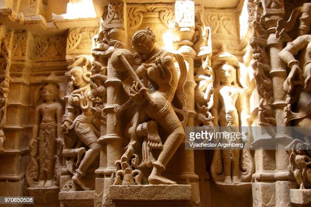 ancient stone carvings inside the jain temple in jaisalmer fort, rajasthan, india - jain stock photos and pictures