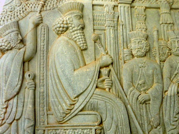 Ancient stone carvings of Iranian Achaemenid and Sassanid kings from Persepolis in the mausoleum for Ferdowsi in Tous, Iran