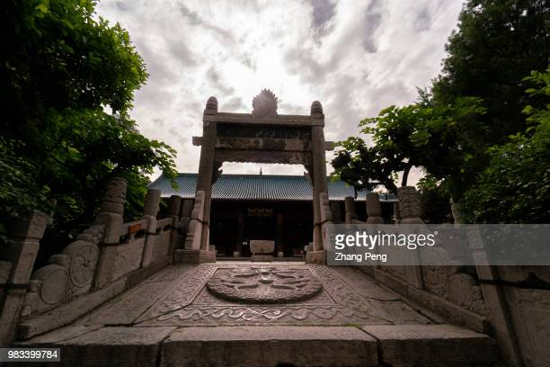 XI'AN SHAANXI PROVINCE CHINA Ancient stone steps and Pailou carved with imperial dragon Xi'an Great Mosque which is a blend of traditional Chinese...