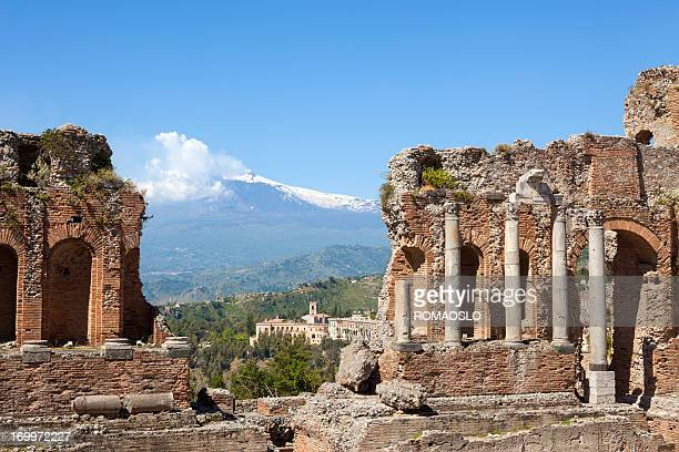ancient teatro greco in taormina and etna, sicily italy - taormina stock photos and pictures