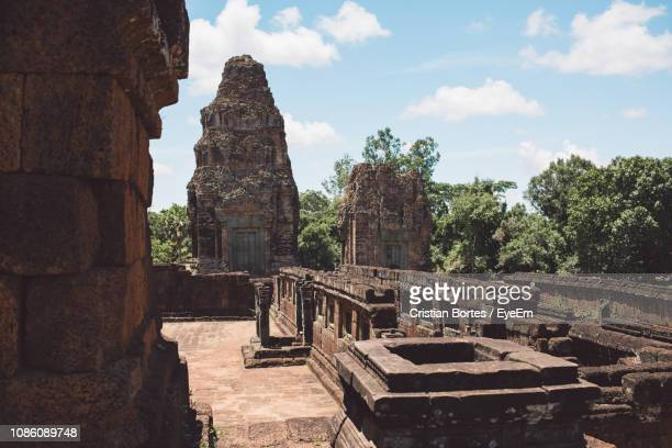 ancient temple and trees against sky - bortes stock pictures, royalty-free photos & images