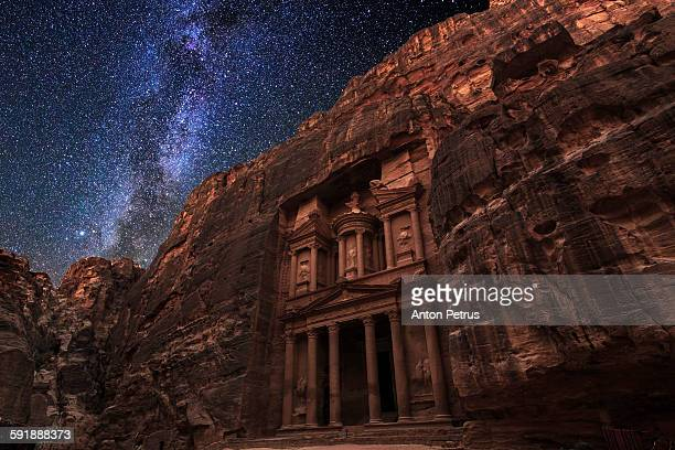 Ancient temple in Petra under the starry sky.