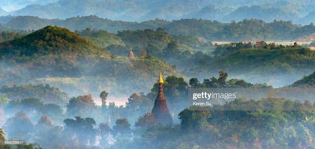 Ancient temples and pagodas in sunrise mist : Stock Photo