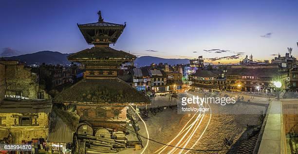 Ancient temples cobbled square zooming lights panorama Bhaktapur Kathmandu Nepal