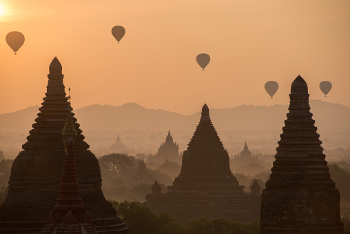Ancient temples with hot-air balloons behind in Bagan, Myanmar. - gettyimageskorea