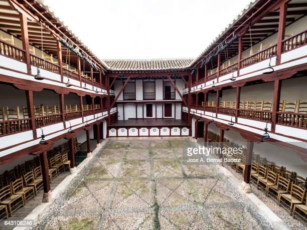 Ancient theatre in a courtyard outdoors. (Corral de comedias de Alamagro).