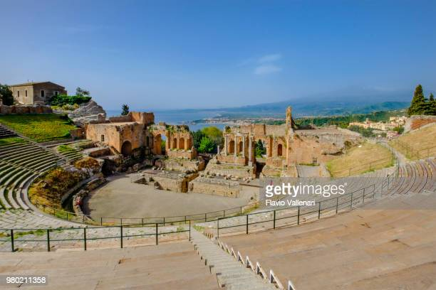 ancient theatre of taormina, an ancient greek theatre built in the 3rd century bc (sicily, italy) - taormina stock pictures, royalty-free photos & images