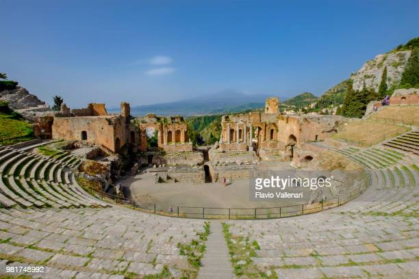 ancient theatre of taormina (sicily, italy) - taormina stock pictures, royalty-free photos & images