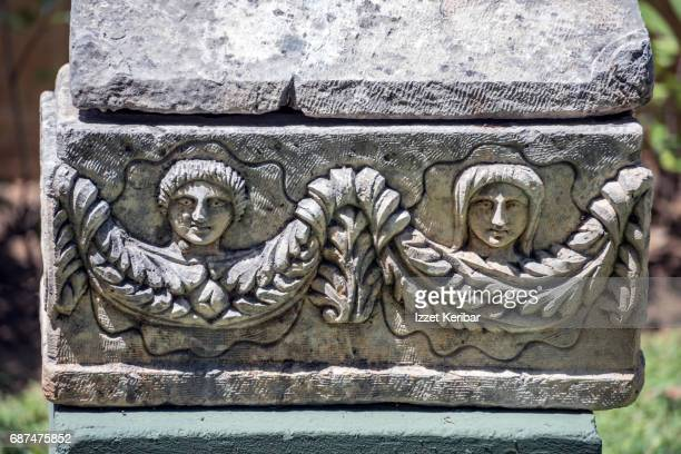 Ancient tomb with nice carvings depicting two maiden heads and guirlandes,Alanya