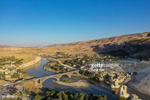 Ancient town of Hasankeyf is seen by the Tigris river which will be significantly submerged by the Ilisu dam on October 01 2019 in Hasankeyf Turkey...
