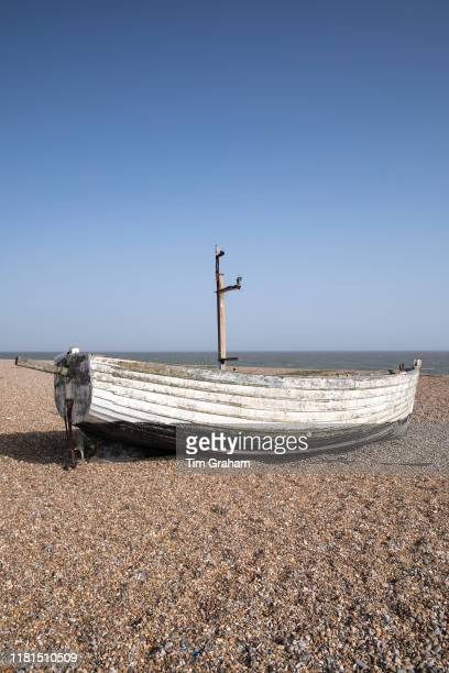 Ancient wooden boat on the beach between Aldeburgh and Thorpeness in Suffolk England United Kingdom