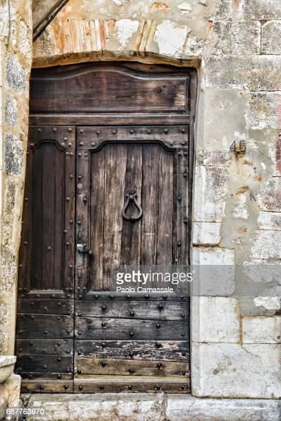 Ancient  wooden door in Vence, France