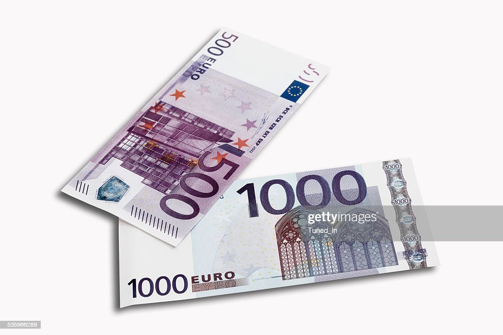 500 and 1000 Euro notes on white background, close-up : Stock Photo