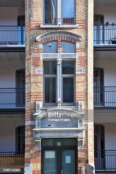 1422 and 2933 Rue Rodenbach Brussels Belgium c2014c2017 Designed by Henri Jacobs 1901 Social housing with yellow and brick facade loggias and...