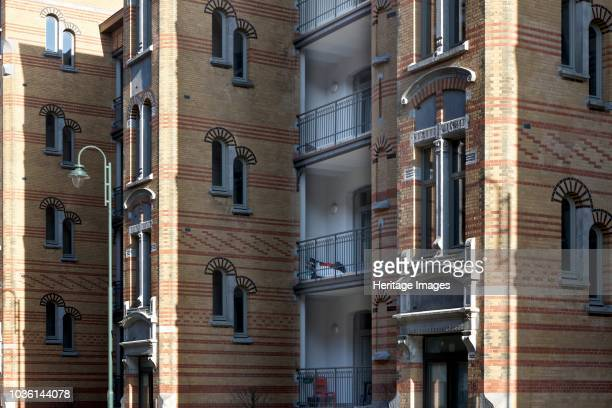 1422 and 2933 Rue Rodenbach Brussels c2014c2017 Designed by Henri Jacobs 1901 Social housing with yellow and brick facade loggias and stairwell acess