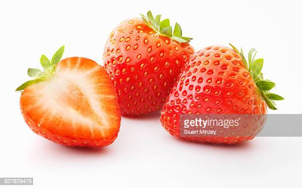 2 and a half strawberries on white background