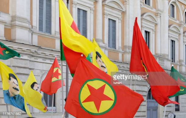 pkk and abdullah ocalan flags in rome, italy - bandiera comunista foto e immagini stock