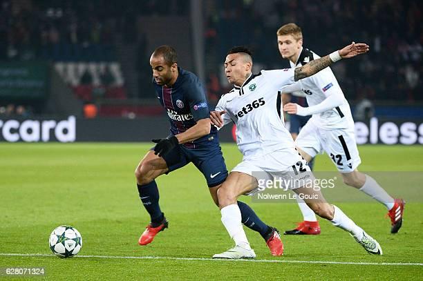 and Abel Anicet of Ludogorets during the Champions League match between Paris Saint Germain and Ludogorets Razgrad at Parc des Princes on December 6...