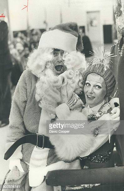 and adults North York Mayor Mel Lastman played Santa for yesterday's children's party and had some help from his wife Marilyn who looked more like a...