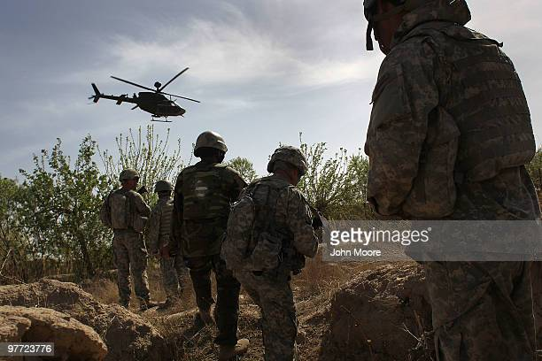 S and Afghan Army soldiers maneuver on patrol with air support shortly before being attacked by Taliban insurgents on March 15 2010 at HowzeMadad in...