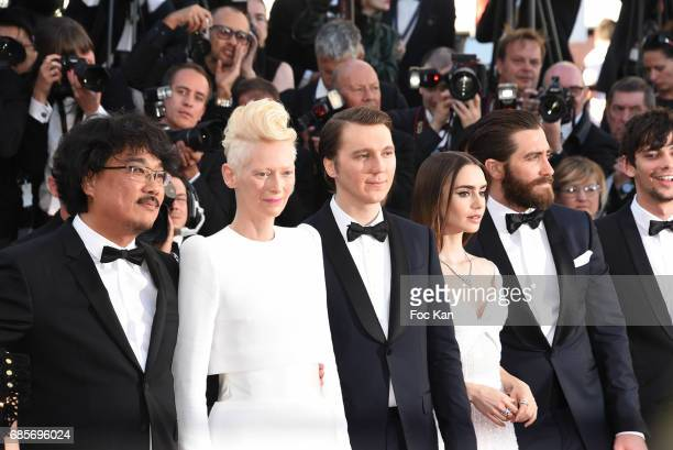 and Ahn Director Bong JoonHo Tilda Swinton actors Paul Dano Lily Collins and Jake Gyllenhaal attend the 'Okja' Screening during the 70th annual...