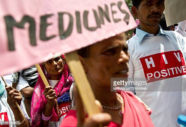 HIV and AIDS campaigners carry placards during a protest rally in New Delhi on April 10 against the negative impact of the EUIndia Free Trade...