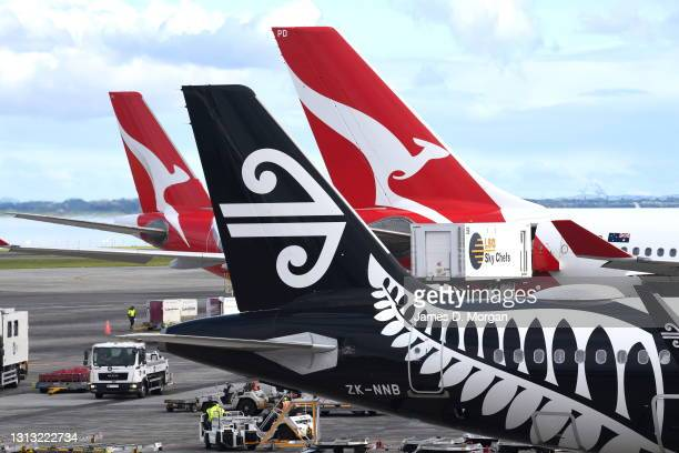 And Air New Zealand planes that recently flew from Australia are parked at the Auckland Airport terminal on April 19, 2021 in Auckland, New Zealand....