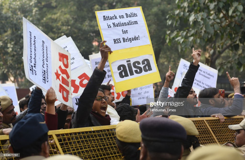 JNUSU and AISA members shout slogans and protest in front of Maharashtra Sadan against the recent violence against dalits, on January 3, 2018 in New Delhi, India.
