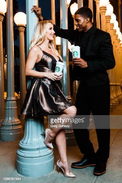 JAY and Amanda Paris enjoy a Starbucks handcrafted coffee beverage at TAPGiveback Day on January 24 2019 in Los Angeles California
