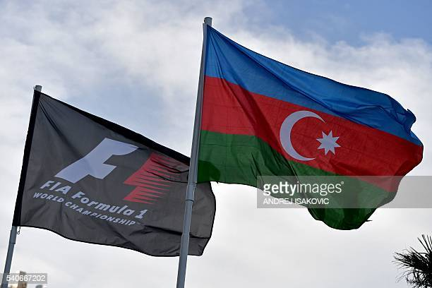 A F1 and an Azerbaijani flags are seen on June 16 2016 in Baku three days ahead of the European Formula One Grand Prix / AFP / ANDREJ ISAKOVIC