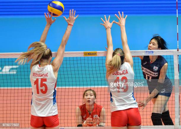 and ANA BJELICA of Serbia in action against JAEYEONG LEE of Korea during FIVB Volleyball Nations League match between Korea and Serbia at the Stadium...