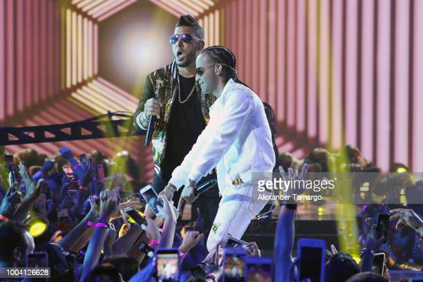 RKM and Arcangel perform on stage at Univision's Premios Juventud 2018 at Watsco Center on July 22 2018 in Coral Gables Florida