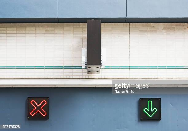 X and Arrow Signs at Entrance to Parking Structure
