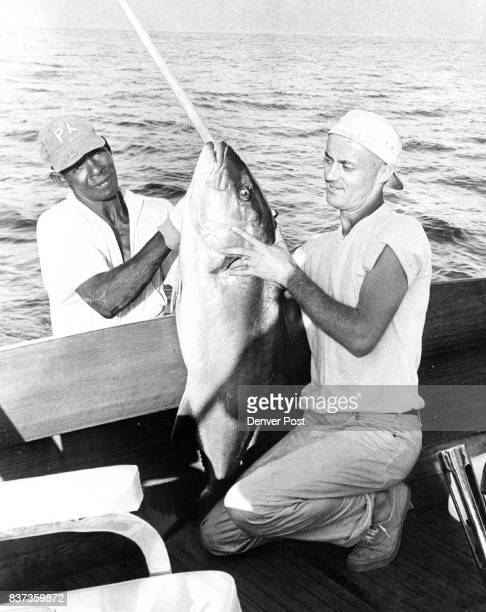 JAN 27 1963 ***** and at right Queal is pictured with 35 pound amberjack Wahoo corvina rooster fish also are plentiful at Pinas bay Credit Denver Post