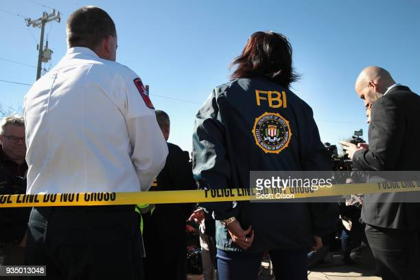 FBI and ATF agents and local officials update the media on their investigation outside a FedEx facility following an explosion on March 20 2018 in...