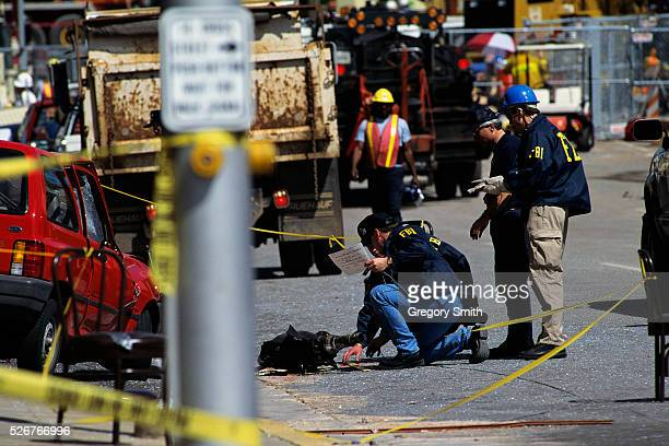FBI and ATF agents search a car transmission thrown by the explosion during the bombing of the Alfred P Murrah Federal Building
