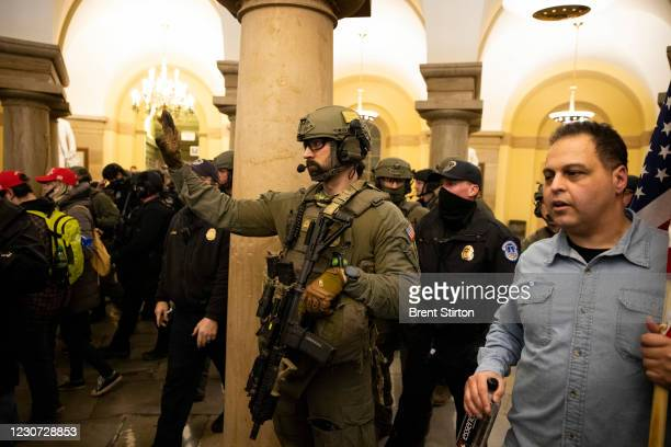 And ATF law enforcement push out supporters of US President Donald Trump as they protested inside the US Capitol on January 6 in Washington, DC....