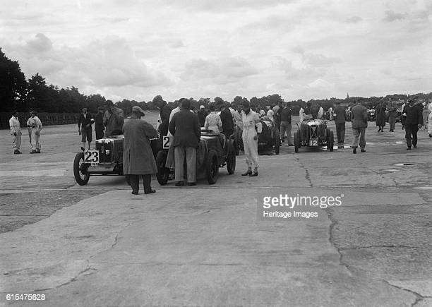And Austin 7 at the LCC Relay GP, Brooklands, 25 July 1931. Left MG 847 cc. Event Entry No: 23A. Right Austin Seven 747 cc. Event Entry No: 22A....