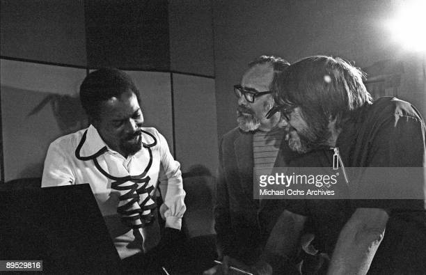 And B and Soul singer Wilson Pickett and producer Jerry Wexler and engineer Tom Dowd chat during a recording session at the Muscle Shoals Sound...
