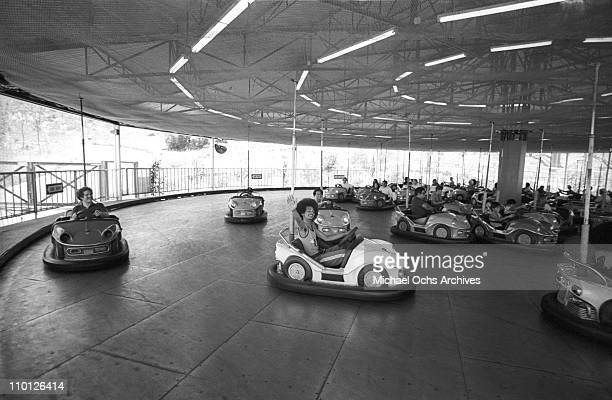 R and B group The Sylvers ride the bumper cars at Magic Mountain on June 22 1973 in Valencia California